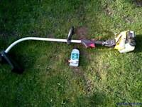 JCB petrol garden trimmer / strimmer with 2 stroke oil
