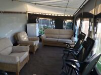 Wicker conservatory furniture. 2 armchairs, 3 seater sofa and 2 glass top coffee tables