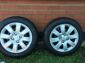 4 partworn tyres with 15inch peugeot hud caps