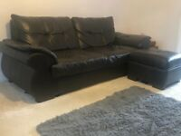 1, 2, 3 seater black leather sofa and matching footstool