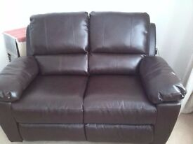 Leather 2 Seater sofa, new with manual recliners.