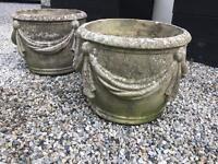 Pair of original stone garden pots.