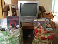 Small TV with VHS and 4 bags of brilliant films to go with it, inc kids and adults films