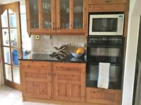 Solid pine kitchen units with granite worktops.