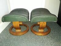 2 dark green leather foot stools