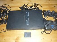 PLAYSTATION 2. EXCELLENT CONDITION WITH TWO CONTROLLERS. FROM A PET AND SMOKE FREE HOME