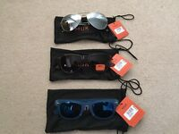 3 pairs of unused sunglasses.