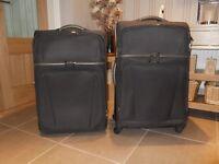 Dark grey Antler suitcases.