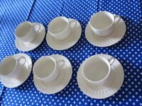 6 off white Cups and Saucers