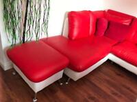 White and red faux leather corner sofa with matching foot stool