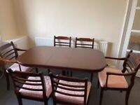 Strongbow extendable dining room table and 6 chairs with leather table protector