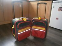 Childrens coloured suitcases/flight bag x 2