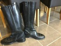 Women's knee high black boots, size 5.