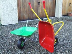 Two wheelbarrows
