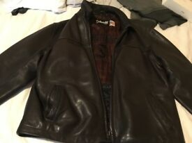 Two men's vintage leather jackets
