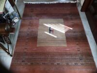 M&S rugs in terracotta colour with design pattern