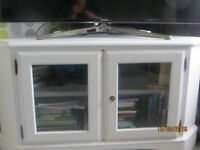 White corner TV unit, vintage style from 'Love Restored.'