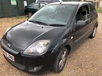 Ford Fiesta Zetec Climate 1242cc Petrol 5 speed manual 3 door hatchback 56 Plate 31/01/2007 Black