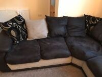 Extremely Comfortable Corner Sofa & Matching Glass Coffee Table in good condition.