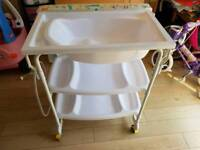 Baby changing table with bath and storage
