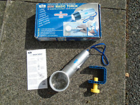 TCL WIND-UP MAGIC TORCH, NO BATTERIES REQUIRED EVER with MAGNIFIER ATTACHMENT and MULTI-ANGLE CLAMP