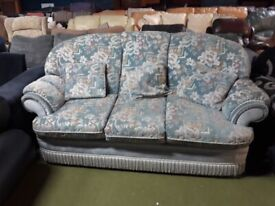 3 seater light green patterned fabric sofa