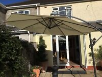 Large Parasol with cantilever used only once and comes with a robust waterproof cover