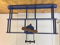 Children's bedroom blue airplane shelves storage