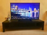 50 Inch 4K Ultra LED TV along with a *high quality TV Table*