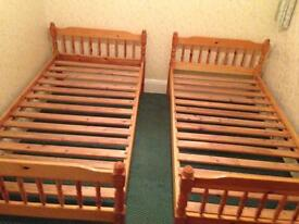 Two pine single bed frames - used but in reasonable condition.