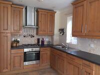 Solid Oak Kitchen with Bosch Appliances. Cooker, integrated dishwasher, fridge & freezer