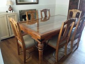 Glass topped solid wood dining table and six chairs - excellent condition