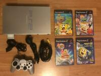 PlayStation 2 console and spongbob games. PS2