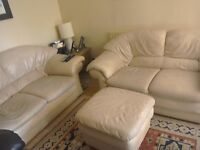 Pair of two seater cream leather settee + footstool
