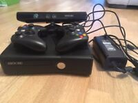 XBOX 360 with KINECT, 2 controllers and 14 various games.