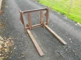 Tractor front loader pallet forks with backplate and Massey Ferguson brackets