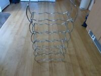 Silver stackable wine rack. Holds 18 bottles