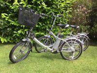 2 electric folding bikes.