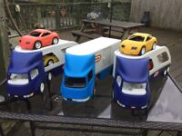 Little tykes large trucks with cars, two car transporters and one box articulated vehicle