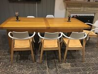 Solid oak dining table. Seats 8 unextended 12 extended