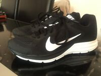 LADIES OR GIRLS SIZE UK 4 NIKE RUNNING SPORTS TRAINERS BLACK AND WHITE BRAND NEW