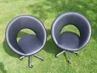 PAIR OF DWELL RETRO BLACK FAUX LEATHER SWIVEL CHAIRS (1960'S). Hardly used and look like new.
