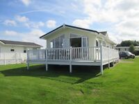 Beautiful 2 Bedroom Caravan / Lodge with wraparound decking and stunning sea views for rent / hire