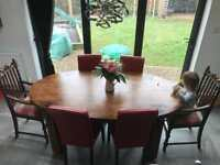 Solid wood chunky farmhouse table and six chairs.