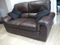 Comfortable, clean brown leather two-seater sofa - free