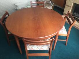 Round dining table with four chairs.