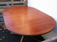 antique table, single pedestal base drop leaf side oval top, solid mahogany, brass castors, 4 seater