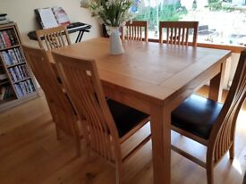 Solid Oak extendable dining table/6 chairs faux leather