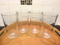 Four pint glasses