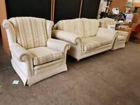 Large striped fabric two seater sofa with two armchairs